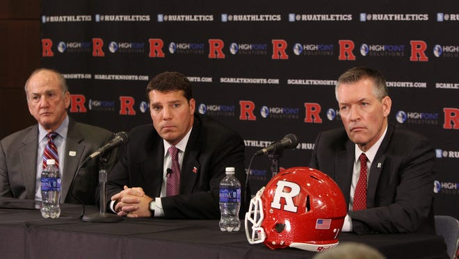 (left) Rutgers University President Robert Barchi and (right) Rutgers University Director of Athletic Patrick Hobbs announce (center) Chris Ash has been named head coach of the Rutgers University Scarlet Knights football program during a press conference in the Hale Center at Rutgers University in Piscataway, NJ Monday December 7, 2015.