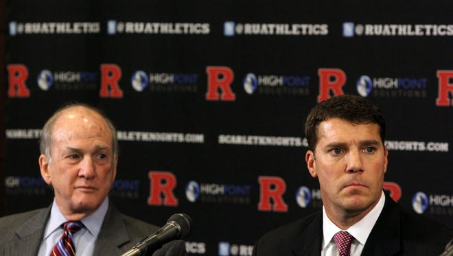 (left) Rutgers University President Robert Barchi and (not pictured) Rutgers University Director of Athletic Patrick Hobbs announce (right) Chris Ash has been named head coach of the Rutgers University Scarlet Knights football program during a press conference in the Hale Center at Rutgers University in Piscataway, NJ Monday December 7, 2015.
