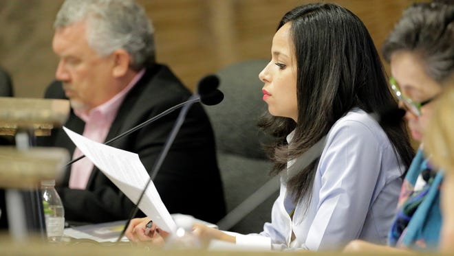 City Rep. Claudia Ordaz looks at list of questions she had for City Manager Tommy Gonzalez. Gonzalez found himself answering questions from other members of City Council on the actions taken on the financial adviser replacement for the city.