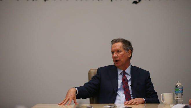 Presidential hopeful and Ohio Gov. John Kasich meets with The Des Moines Register's editorial board on Thursday, Dec. 17, 2015, in Des Moines.