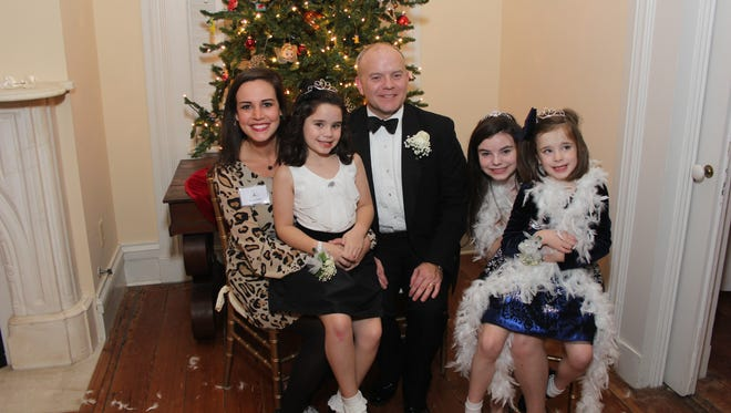 Geoff Stough, seated center, with, from left, his niece Katie Jones, a Landmarks Foundation board member; and his daughters Meg, Josie and Zoe, at the 2015 Diamond Princess Ball hosted in Old Alabama Town at the Ware-Farley-Hood House.
