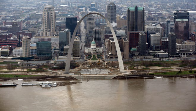 The Mississippi River flows past the Gateway Arch in St. Louis. A rare winter flood threatens nearly two dozen federal levees in Missouri and Illinois on Wednesday as rivers rose, prompting evacuations in several places.