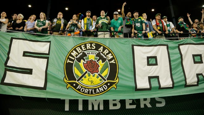 Portland Timbers fans are shown during their MLS soccer match against Sporting Kansas City  in Portland, Ore., Wednesday, Sept. 9, 2015. (AP Photo/Don Ryan)