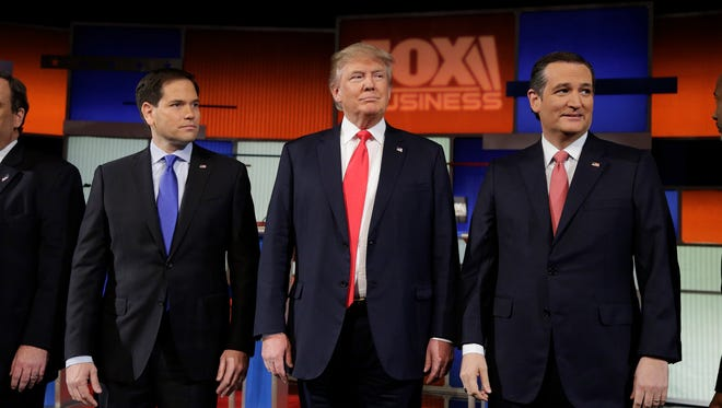 Republican presidential candidates Sen. Marco Rubio, R-Fla., from left, Donald Trump and Sen. Ted Cruz, R-Texas, stand on stage before the Fox Business Network Republican presidential debate Thursday at the North Charleston Coliseum in North Charleston, S.C.