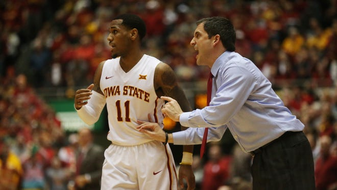 Iowa State's Monte Morris talks to his coach Steve Prohm during the Cyclones men's basketball game against No. 1 Oklahoma on Monday, Jan. 18, 2016, in Hilton Coliseum. The Cyclones beat the Sooners 82-77.
