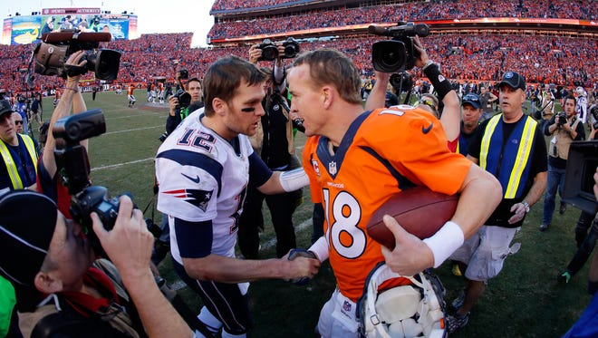 Patriots quarterback Tom Brady, left, congratulates  Peyton Manning #18 of the Denver Broncos after the Broncos defeated the Patriots in the AFC Championship game Jan. 19, 2014, in Denver. They will face each other again on Sunday in the AFC Championship game.