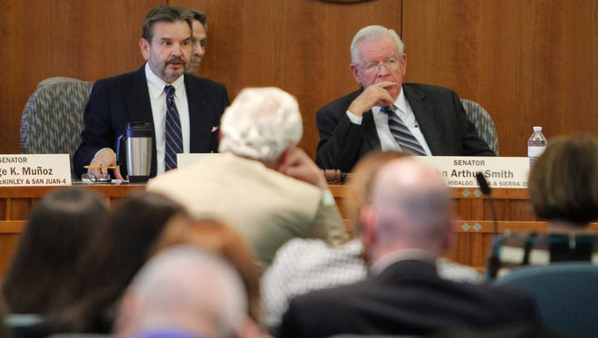 New Mexico Sen. Carlos R. Cisneros, D-Questa, left, and Sen. John Arthur Smith, D-Deming, listen to David Abbey, legislative finance committee director, speak to the Legislative Finance Committee on  Wednesday about the state's new revenue outlook.