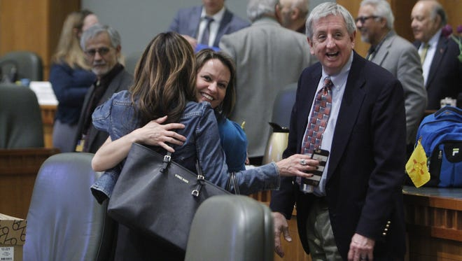 Representative Stephanie Garcia Richard, D-LosAlamos, and Representative Monica Youngblood, R-Albuquerque, hug each other goodbye after the 2016 legislative session ended on Thursday, February 18, 2016.