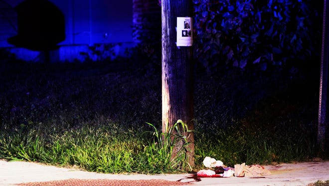 Blood-soaked towels and clothing abandoned on the corner of Bernard and Cornelius avenues where Clarence Wade Havvard, III, was shot and killed Aug. 26, 2015.