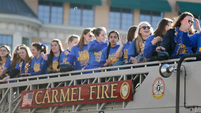 The Carmel Girls Swim Team was honored with a parade through downtown Carmel on Saturday, Feb. 20, 2016, to celebrate their national record of 30 consecutive state championships.