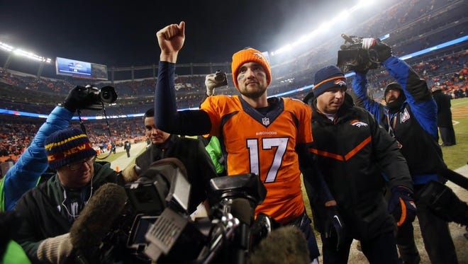 Denver Broncos quarterback Brock Osweiler (17) celebrates after the game against the Cincinnati Bengals at Sports Authority Field at Mile High.