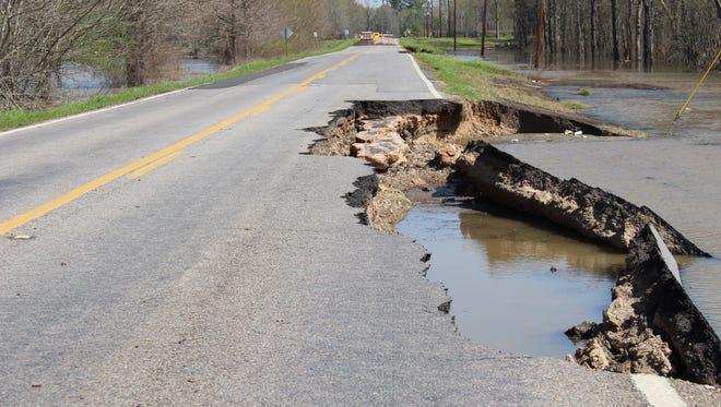 A portion of roadway collapsed along the Cheniere spillway. At intermittent locations along approximately one mile of roadway, the east side shoulder has washed away.