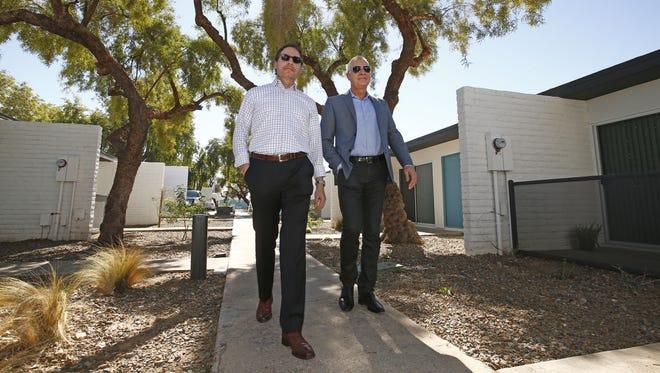 Brian A. Smuckler with CBRE, Inc. and Kurt Rosene with Novo Development walk through the Rezide apartment complex in Phoenix.