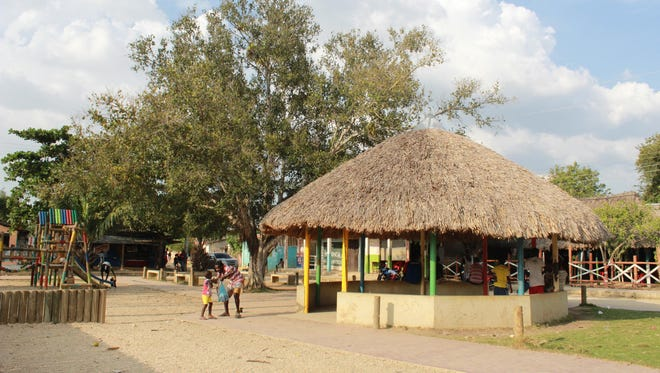 A playground and community gathering area are part of the main plaza in San Basilio de Palenque, a town of about 4,000 residents. Palenque is a town in northern Colombia where locals speak their native language of Palenquero, which underwent an unprecedented revival in the 1980s and '90s.
