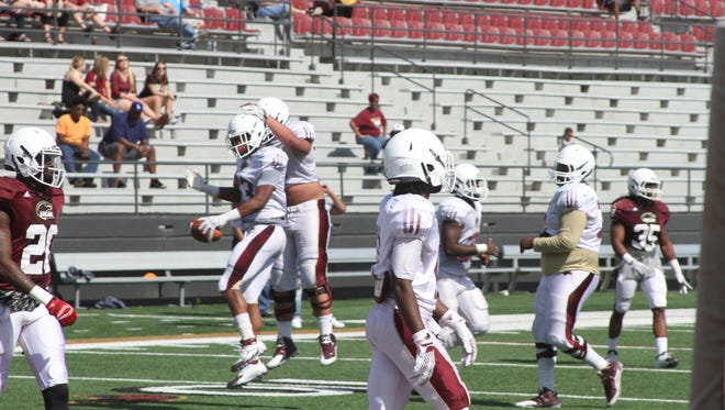 D'Marius Gillespie (83) celebrates with the ULM offensive line after catching a touchdown pass. The sophomore wide receiver hauled in two scores from quarterback Garrett Smith.