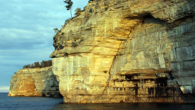 Beautiful colors are seemingly painted on the sandstone cliffs of Pictured Rocks National Lakeshore.