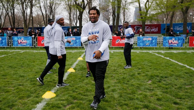 Former Ole Miss defensive tackle Robert Nkemdiche laughs with other prospects during a NFL Draft Play 60 event at Grant Park in Chicago Wednesday. Nkemdiche is one of the more debated prospects in this year's NFL Draft.