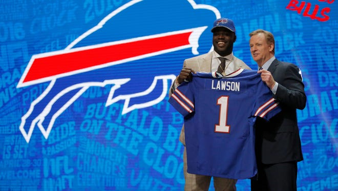 Shaq Lawson of Clemson holds up a jersey with NFL Commissioner Roger Goodell after being picked No. 19 overall by the Buffalo Bills during the first round of the NFL Draft.