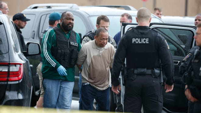 Police take Eulalio Tordil, 62, a suspect in three fatal shootings in the Washington, D.C., area into custody in Bethesda, Md., on May 6, 2016.