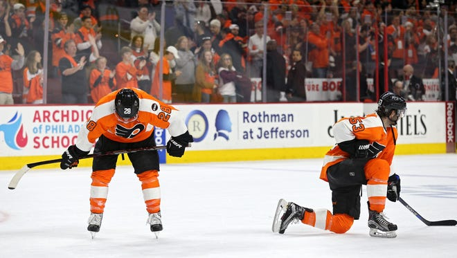 Claude Giroux, left, and Shayne Gostisbehere will both have abdominal and right hip surgeries on Tuesday.