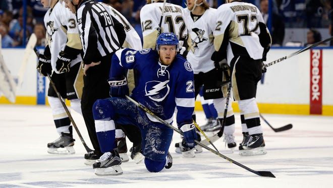 Slater Koekkoek of the Tampa Bay Lightning goes to one knee after Nick Bonino of the Pittsburgh Penguins scored an open-net goal during the third period.