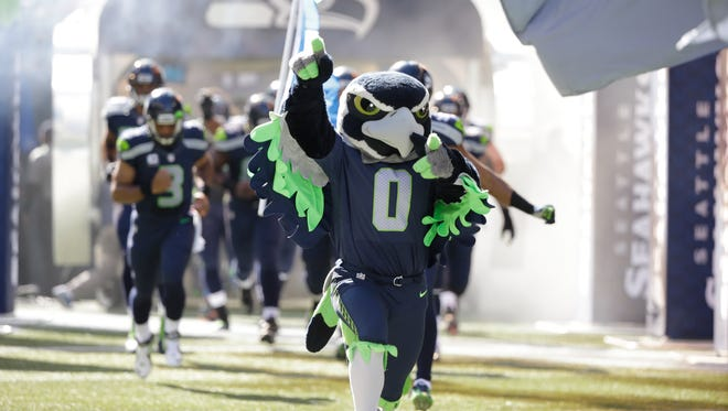 Blitz, the Seattle Seahawks mascot, leads the team out of the tunnel for an NFL football game against the Chicago Bears, Sunday, Sept. 27, 2015, in Seattle. (AP Photo/Elaine Thompson)