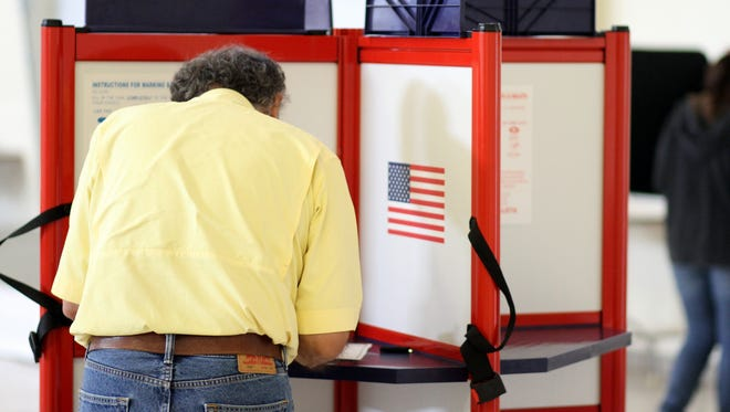 A Luna County voter marks his ballot in the 2016 federal election.