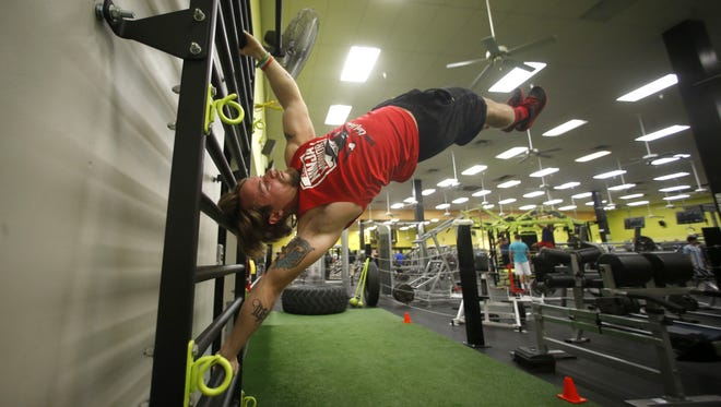 Danny Adair, who has made it to the finals of the American Ninja Warrior television show, trains at Gold's Gym on Friday, June 10, 2016.