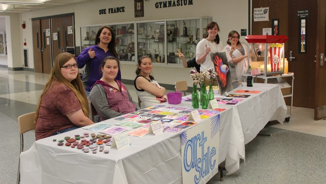 Members of the Newfield Art Club at the annual art sale. From left, Abigail Teeter, Destani Ketter, Chassity Hulbert, Megan Heroux, Jordann McKenna and Reanna Furman. Dylan Riley is behind McKenna and Furman at right.