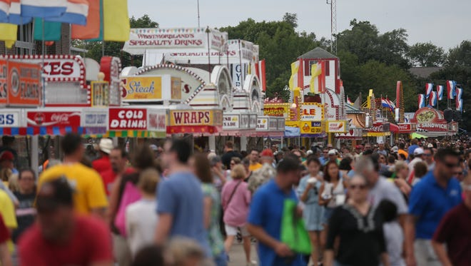 A sea of people make their way down the Grand Concourse on the second to last day of the 2015 Iowa State Fair, Saturday, August 22, 2015 in Des Moines.