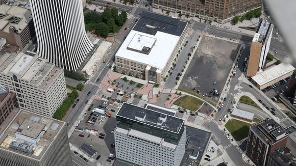 Aerial view of the Midtown area of downtown Rochester with an empty Parcel 5, Mid right.