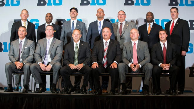 Big Ten football coaches gather for a group photo Tuesday, July 26, 2016, in Chicago.