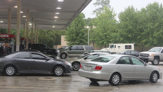 Cars line up outside a Tallahassee gas station ahead of Hurricane Hermine in late August.