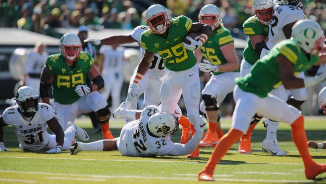 Sep 24, 2016; Eugene, OR, USA; Oregon Ducks running back Kani Benoit (29) is tackled by Colorado Buffaloes linebacker Rick Gamboa (32) in the first half at Autzen Stadium. Mandatory Credit: Scott Olmos-USA TODAY Sports