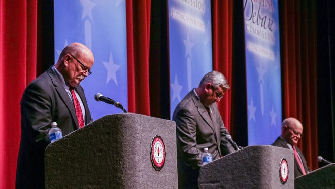 Left to right, Gubernatorial Candidates, Democrat John Gregg, Republican Lt. Gov. Eric Holcomb, and  Libertarian Rex Bell, face of in a debate held at Ransburg Auditorium, on the University of Indianapolis campus, Monday October 3rd, 2016. John Ketzenberger, president of the Indiana Fiscal Policy Institute moderated the event.