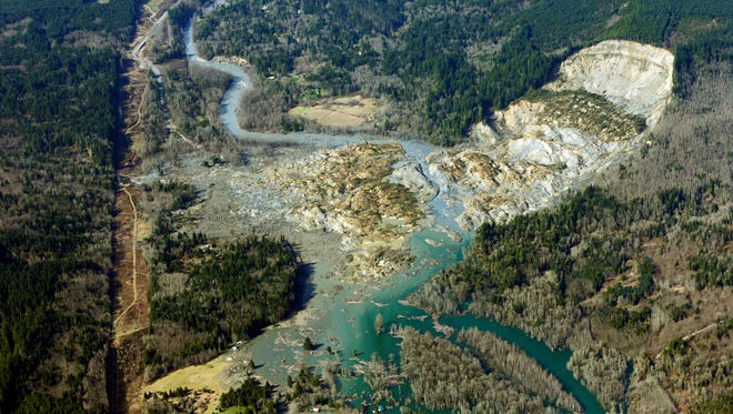 In this March 24, 2014, photo, the massive mudslide that killed 43 people in the community of Oso, Wash., is viewed from the air.