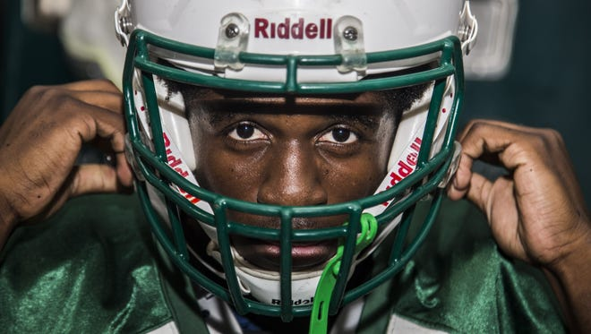 Phoenix St. Mary's senior defensive end Odua Isibor poses for portraits at St. Mary's High School on October 10, 2016 in Phoenix.