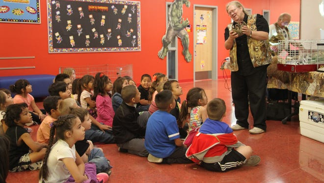 ABQ Biopark docent Anne Bennett shows first grader students Callaway the armadillo on Tuesday.