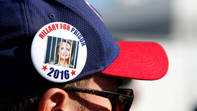 "An unidentified Trump supporter wears a ""Hillary for Prison"" button as he waits in line Oct. 18, 2016, for a rally where Republican presidential candidate Donald Trump will speak in Grand Junction, Colorado."