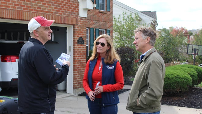 Michael Cox, of Independence, talks with Kim Moser, who is running for state representative, and U.S. Sen. Rand Paul on Oct. 22 while Paul campaigns in Northern Kentucky.