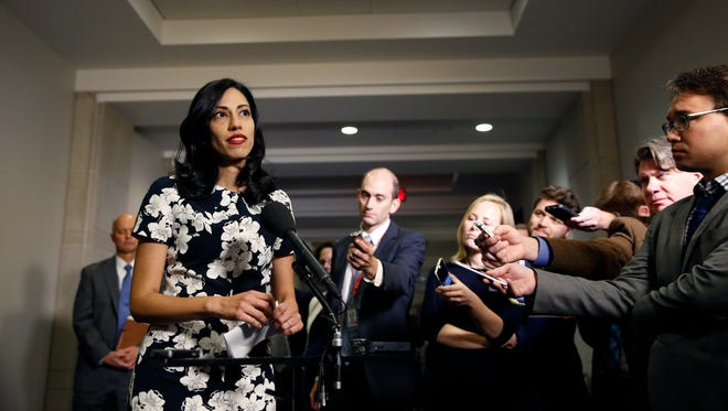 In this Oct., 16, 2015 file photo, Huma Abedin, a longtime aide to Hillary Clinton, speaks to the media after testifying at a closed-door hearing of the House Benghazi Committee, on Capitol Hill in Washington.
