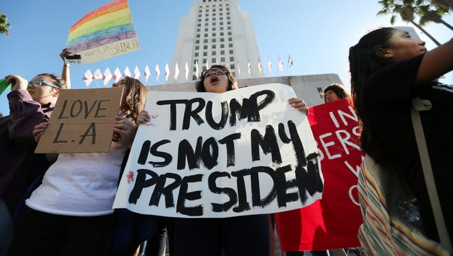Students from several high schools rally after walking out of classes to protest the election of Donald Trump at City Hall in downtown Los Angeles Monday, Nov. 14, 2016. (AP Photo/Reed Saxon)