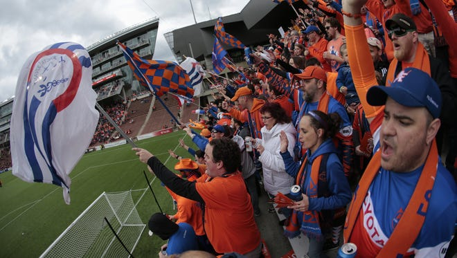 FC Cincinnati fans pack the stadium for a match last year. The soccer team shop offers a variety of gear, including themed winter accessories.