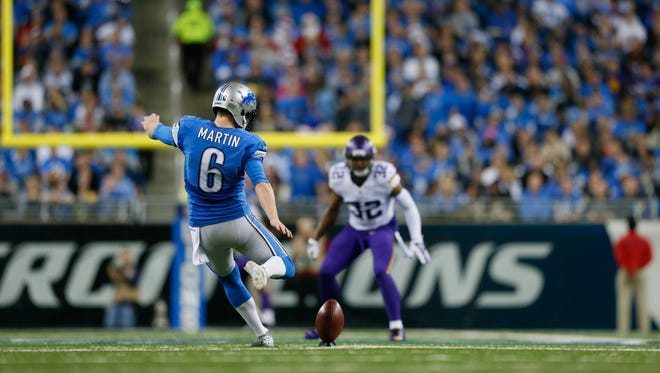 Detroit Lions punter Sam Martin (6) kicks to the Minnesota Vikings at Ford Field in Detroit on Dec. 14, 2014.