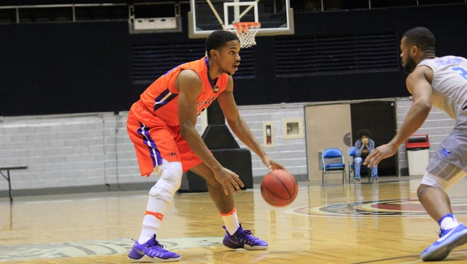 Evansville junior Duane Gibson handles the ball in front of Middle Tennessee's Antwain Johnson on Sunday at Nashville Municipal Auditorium.