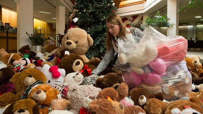 Lee Malone bags teddy bears collected by American Bank locations in Corpus Christi and Port Aransas for the Women's Shelter of South Texas, Wednesday, Jan. 6, 2016. American Bank collected 637 teddy bears for last years drive.