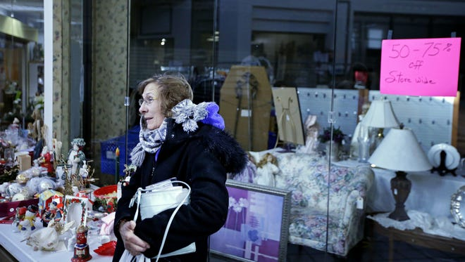 """Kathy McEwen of Menasha, shopping Saturday at the Northland Mall in Appleton, says she prefers shopping in person rather than online. """"Kohl's is one of the stores I go to to get presents and get their deals,"""" she said."""