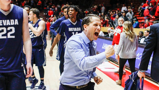 Nevada head coach Eric Musselman celebrates his team's win over New Mexico on Saturday. Nevada rallied from a 25-point second-half hole to win 105-104 in overtime.