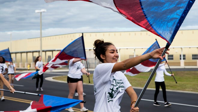 Deena Alani, 17, practices with the Palmetto Ridge marching band after school on Tuesday, Jan. 10, 2017. The band was selected to attend the presidential inauguration in Washington, D.C., on Jan. 20 and has recently surpassed its $135,000 fundraising goal to finance the trip.