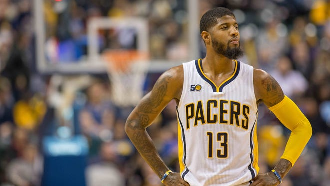 Indiana Pacers forward Paul George (13) says he's doing what he loves to do.